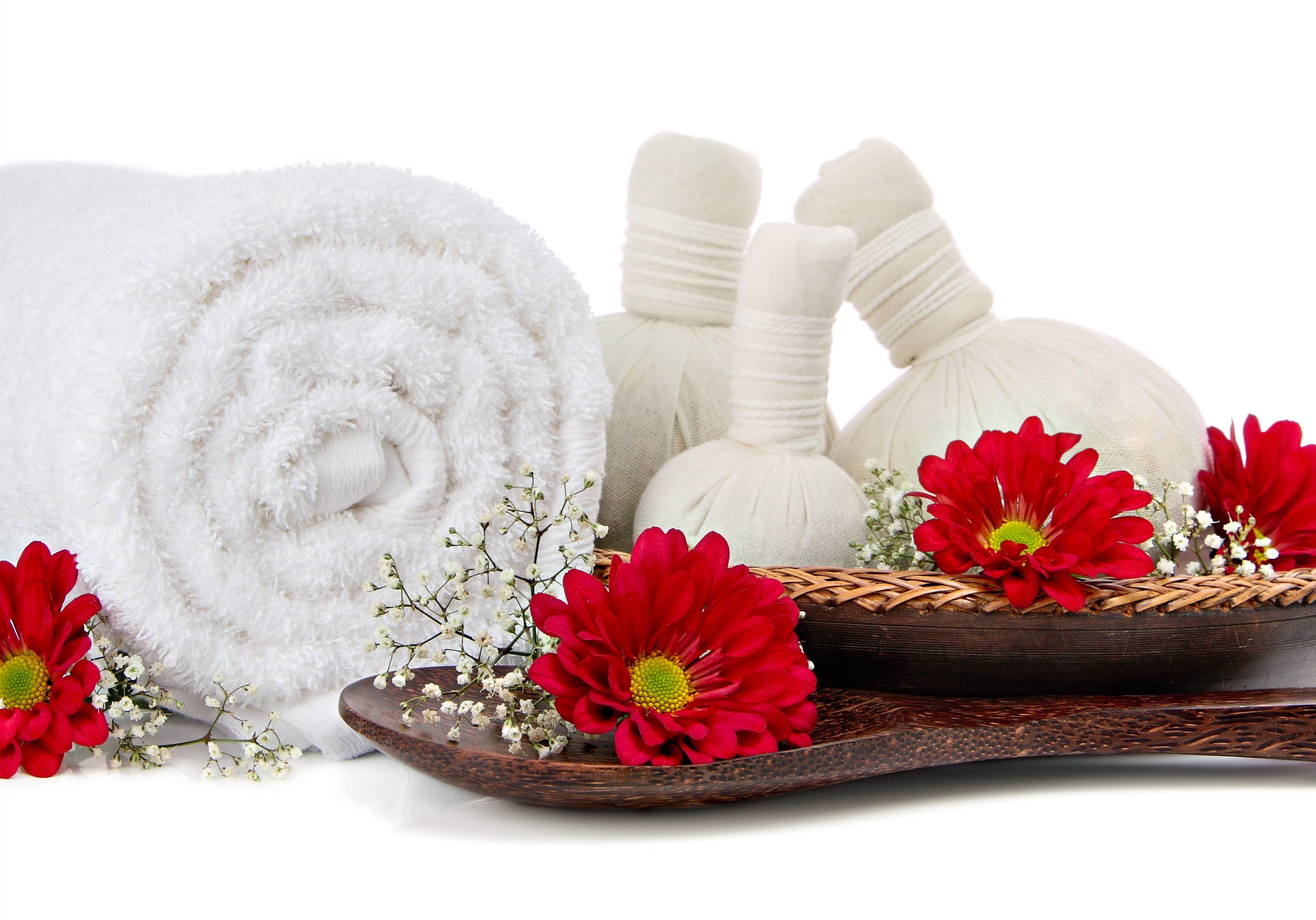 Spa massage setting with a fluffy towel, thai herbal compress massage balls